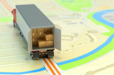 A toy delivery truck full of packages makes its way across a literal map.